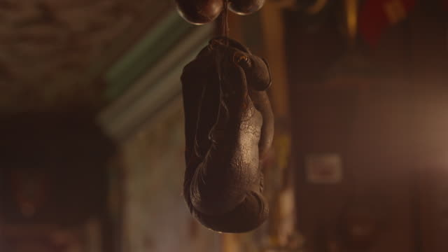 Shot of an antique pair of boxing gloves hung from the ceiling of a bar in Paris, France