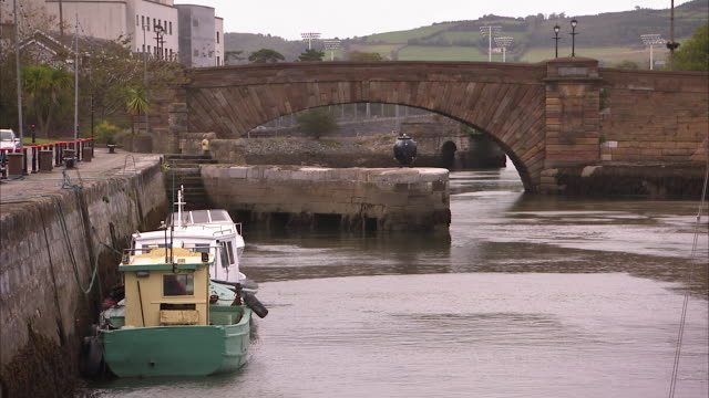shot of an old irish canal with boats anchored - anchored stock videos & royalty-free footage