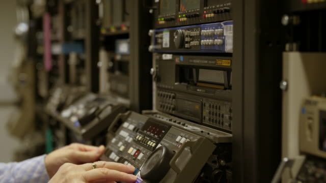 shot of an operator ejecting a tape from a digibeta machine - adults only videos stock videos & royalty-free footage