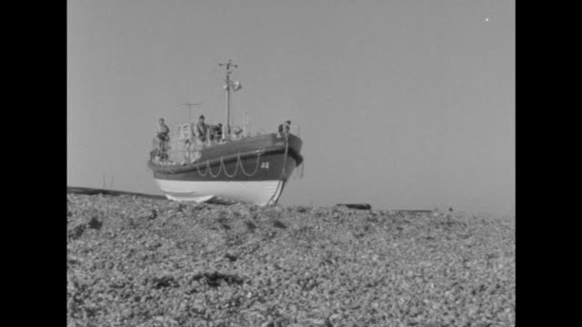 Shot of an RNLI lifeboat being launched from Dungeness