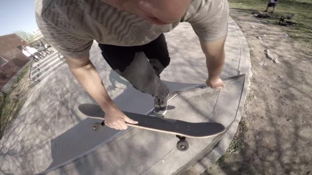 pov shot of an unrecognizable caucasian man skateboarding through a skatepark - skateboard park stock videos & royalty-free footage