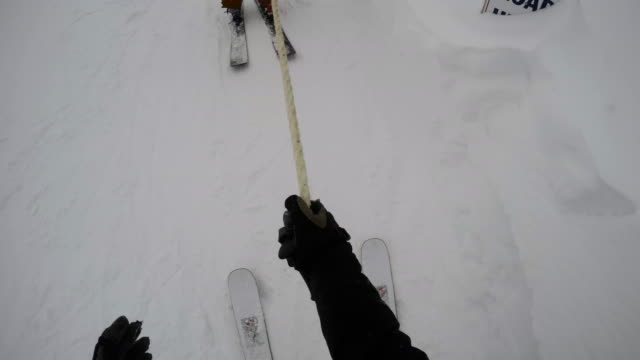 pov shot of an unrecognizable, real person getting ready to go skiing - 4k - skijacke stock-videos und b-roll-filmmaterial