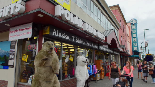cu shot of anchorage alaska capital city tourists on 4th avenue and f street with polar bear gift shop / anchorage, alaska, united states - anchorage alaska stock videos & royalty-free footage