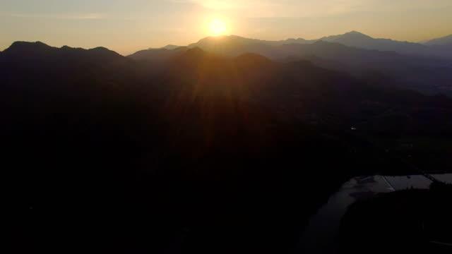 stockvideo's en b-roll-footage met aerial shot of ancient dwellings at sunset/zhejiang, china - natuurwonder