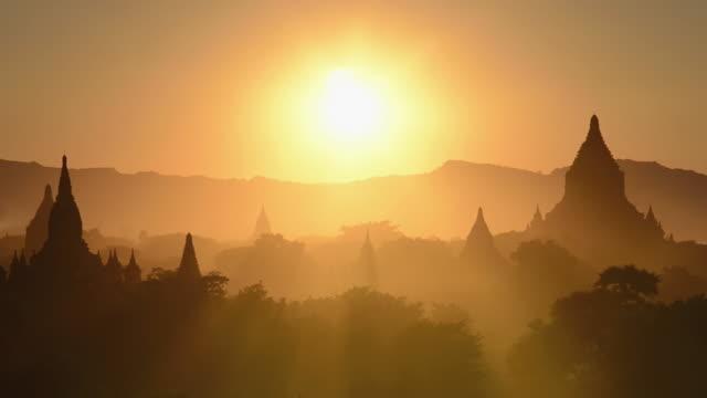 WS Shot of Ancient temples at Pagodas field at sunset / Bagan, Mandalay Division, Myanmar