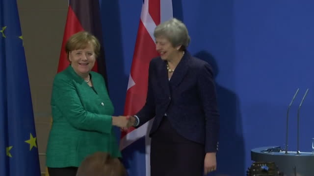 Shot of Angela Merkel and Theresa May shaking hands after their conference in Berlin Germany