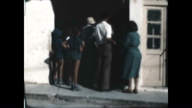 shot of anglo palestine bank from a home movie in 1948 - bankenschild stock-videos und b-roll-filmmaterial