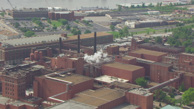 MS AERIAL TS ZO Shot of Anheuser Busch brewery and river / St Louis, Missouri, United States