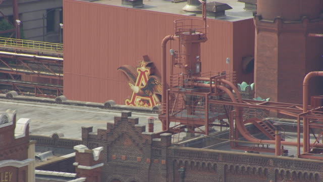 MS AERIAL Shot of Anheuser Busch logo on building at brewery / St Louis, Missouri, United States