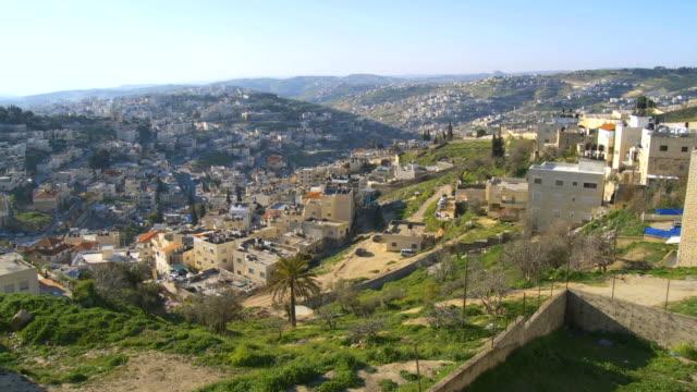 WS PAN Shot of arab villages in east Jerusalem and occupied territories devided by Israeli West Bank barrier / Jerusalem, Judea, Israel