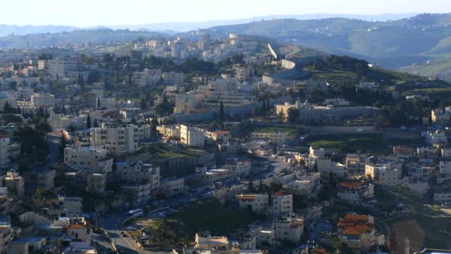 ms shot of arab villages in east jerusalem and occupied territories devided by israeli west bank barrier / jerusalem, judea, israel - palestinian territories stock videos & royalty-free footage