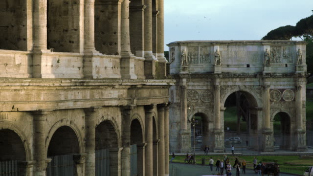 shot of arch of constantine with colosseum in the foreground. - arch of constantine stock videos and b-roll footage