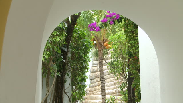 vídeos de stock, filmes e b-roll de ms tu shot of  archway framing waterfall and beautiful garden at boutique hotel resort / playa del carmen, quintana roo, mexico - quintana roo