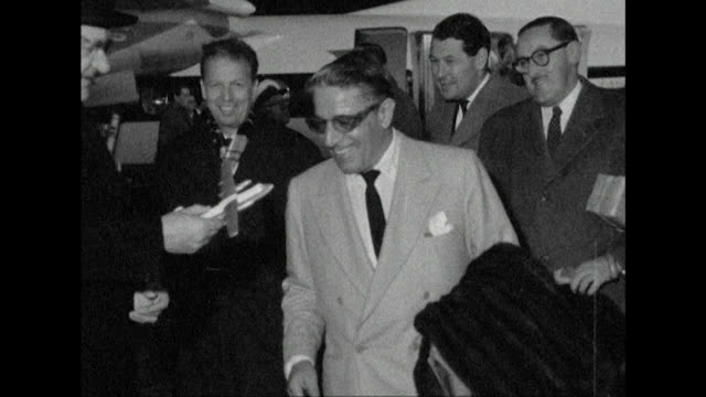 Shot of Aristotle Onassis arriving at London Airport