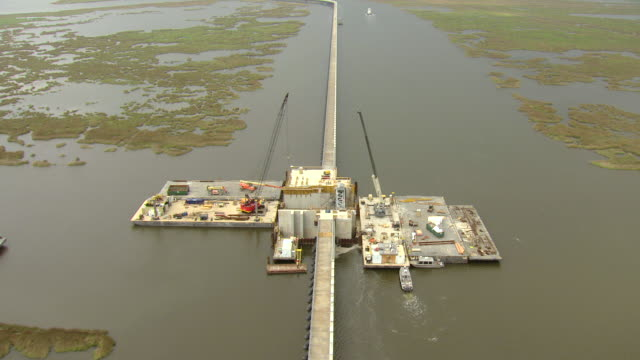 ms aerial ts shot of army corps of engineers inner harbor navigation canal lake borgne surge barrier / louisiana, united states - canal stock videos & royalty-free footage