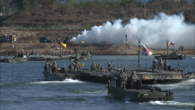 Shot of army soldiers in the boats on the water for military exercise