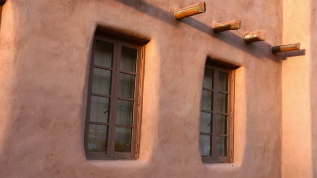 MS Shot of artwork on stucco buildings / Santa Fe, New Mexico, United States