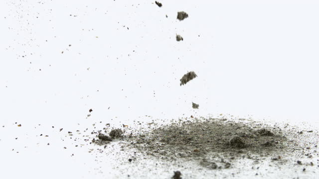 cu slo mo shot of ashes falling against white background / calvados, normandy, france - cenere video stock e b–roll