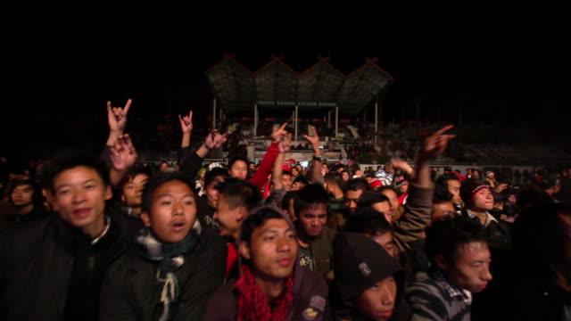 MS Shot of audience enjoying popular music concert / Kohima, Nagaland, India