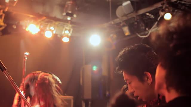 ms pan shot of audience head banging / shimokitazawa, tokyo, japan - head banging stock videos & royalty-free footage