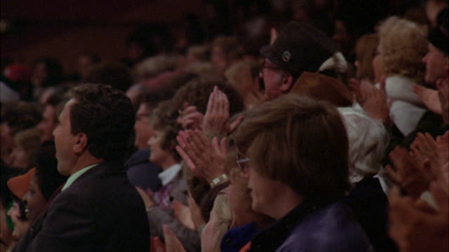 ms zi zo shot of audience standing and clapping at ice skating rink floor in 1978 united states national championship at ice rink (sports arena) in denver colorado - audience stock videos and b-roll footage
