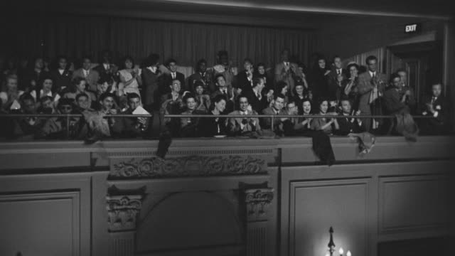 ms shot of audience wearing formal attire in balcony watching and applauding - audience stock videos & royalty-free footage