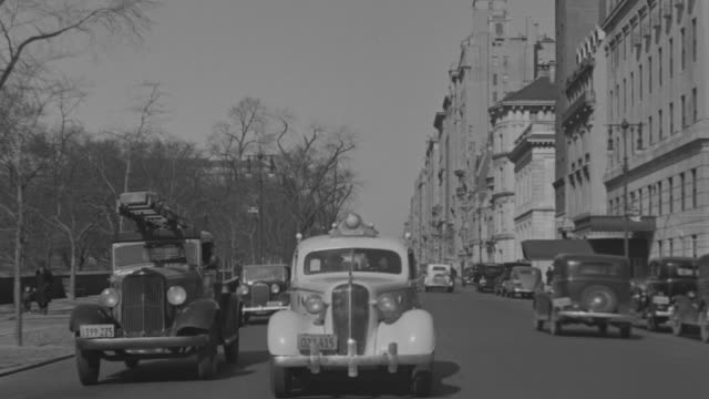 ms pov shot of auto driving south on 5th ave, straight back - 1930 video stock e b–roll