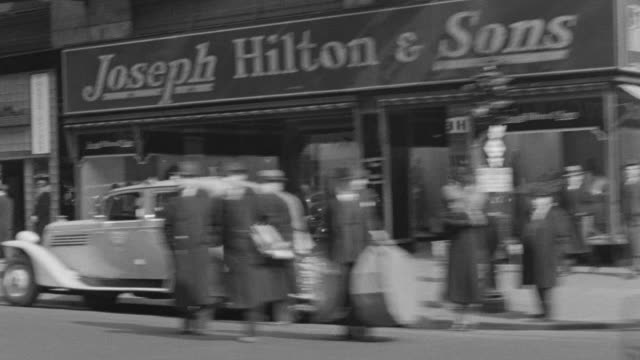 ws pov shot of auto driving south on broadway, columbus circle and times square - 1937 stock videos and b-roll footage