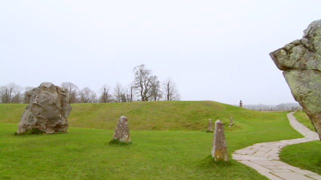 ms pan shot of avebury rocks and landscape / wiltshire, england, united kingdom - wiese stock videos & royalty-free footage