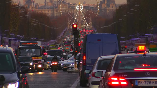 MS Shot of Avenue des Champs Elysees with traffic / Paris, Ile de France, France