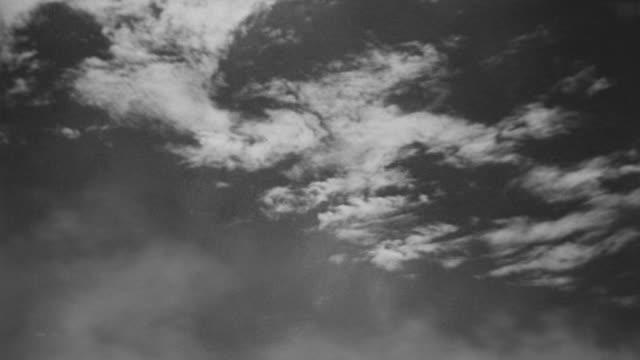 MS TS Shot of B17 flight through clouds
