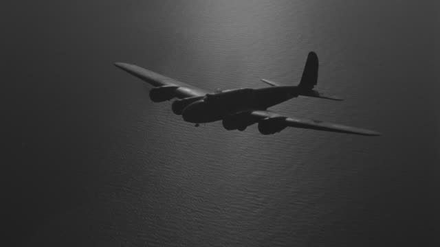 ms aerial shot of b-17 in flight flying over ocean - us airforce stock videos & royalty-free footage