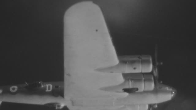 cu la ts shot of b-17 planes in flight and firing at night - tracking shot stock videos & royalty-free footage