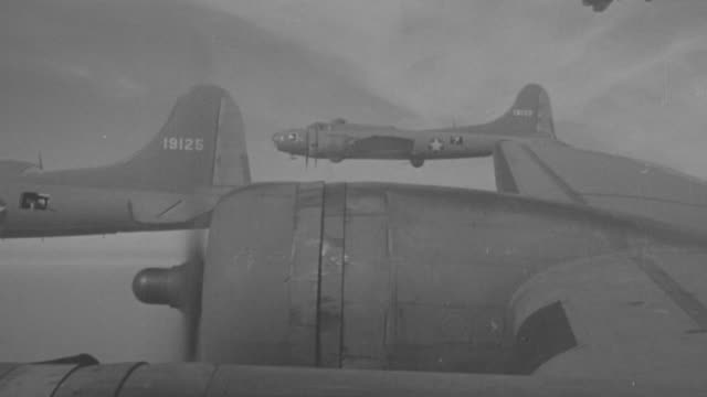 cu shot of b-17 planes in flight from left to right - bomber plane stock videos and b-roll footage