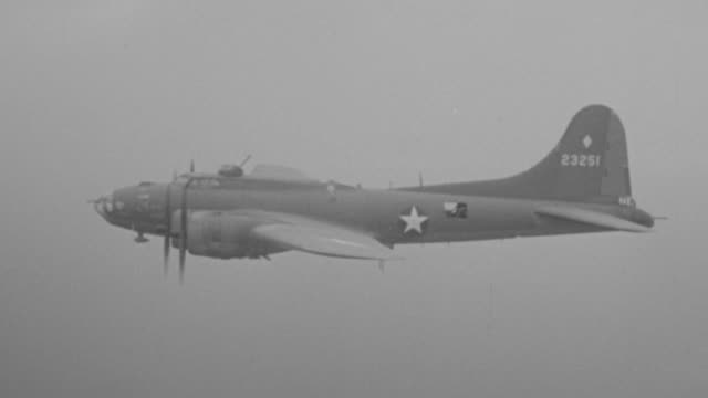ms shot of b-17 planes in flight from left to right - united states airforce stock-videos und b-roll-filmmaterial