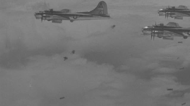 stockvideo's en b-roll-footage met aerial pov shot of   b17s in formation above clouds  - tweede wereldoorlog