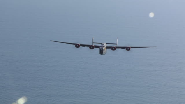 aerial ws shot of b-24 bomber flying out at sea / florida, united states - bomber plane stock videos and b-roll footage