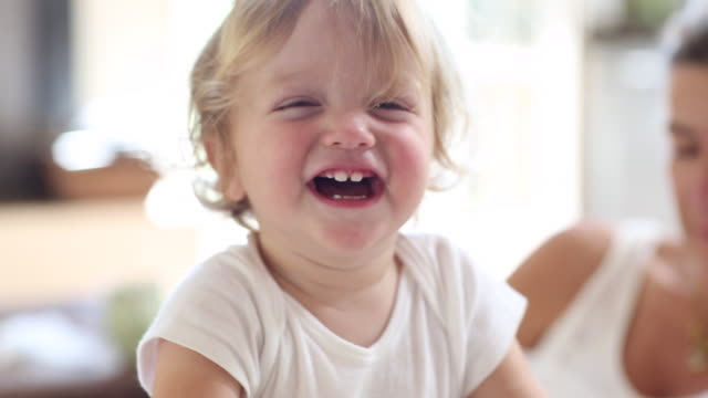ms shot of baby boy laughing / santa fe, new mexico, united states  - innocenza video stock e b–roll