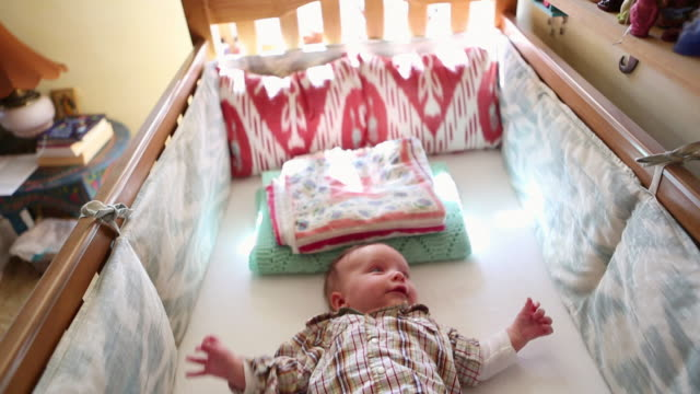 ms td shot of baby looking at his mobile in his crib / lamy, new mexico, united states - lamy new mexico stock videos and b-roll footage