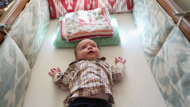 ms shot of baby lying awake in his crib / lamy, new mexico, united states - lamy new mexico stock videos and b-roll footage
