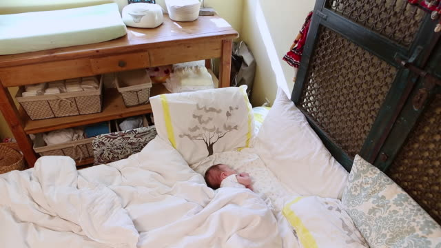 ms td shot of baby sleeping in big bed / lamy, new mexico, united states - lamy new mexico stock videos and b-roll footage