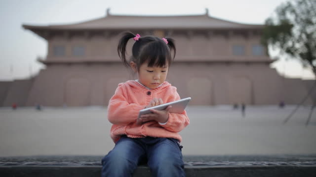 ms shot of babygirl playing games using digital tablet computer / xi'an, shaanxi, china - children only stock videos & royalty-free footage