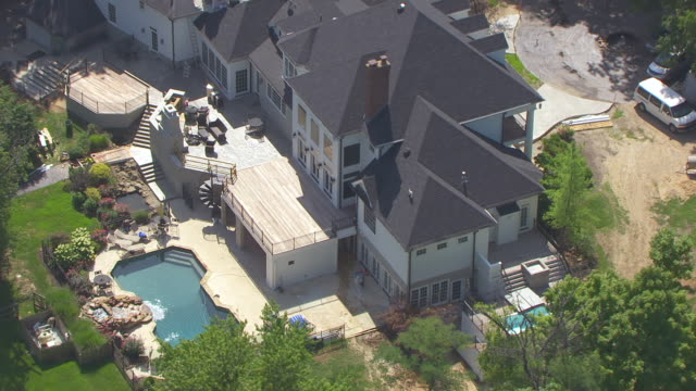 ms aerial shot of back of august busch iv mansion and backyard pool / huntleigh, missouri, united states - anheuser busch inbev stock videos and b-roll footage