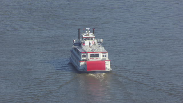 ms aerial shot of back side of mark twain riverboat traveling on mississippi river / hannibal, missouri, united states - mark twain stock videos & royalty-free footage