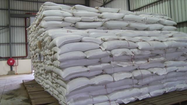 MS PAN Shot of bags of Pilsen malt piled high on pallet / Wau, Western Bahr el Ghazal, Sudan