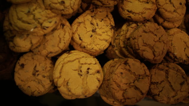 ha slo mo shot of baked cookies in bakery/ johannesburg/ south africa - chocolate chip cookie stock videos and b-roll footage