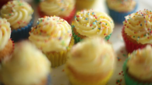 cu pan r/f shot of baked cupcakes on cake stand / auckland, new zealand - cupcake stock videos and b-roll footage