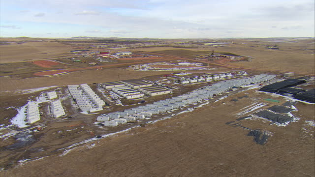 WS AERIAL DS Shot of Bakken oil field temporary worker housing (known locally as 'man camp') near Watford City / Watford City, North Dakota, United States