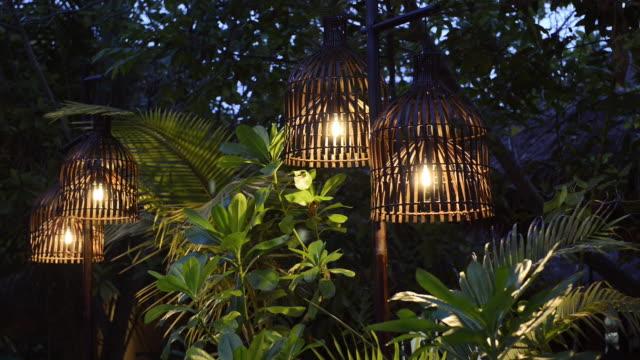 MS Shot of Bamboo lanterns in tropical garden at night / Ko Kradan, Trang, Thailand
