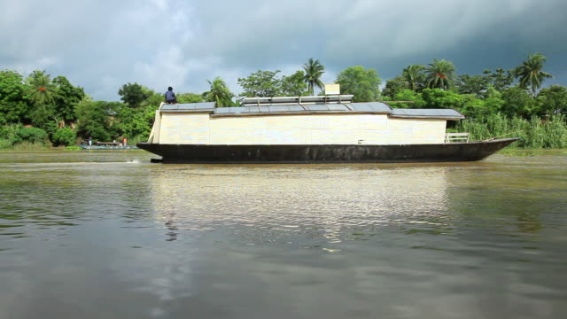 ws shot of bamboo school boat with solar panels on roof travels on river / pabna, bangladesh - bangladesh stock videos & royalty-free footage